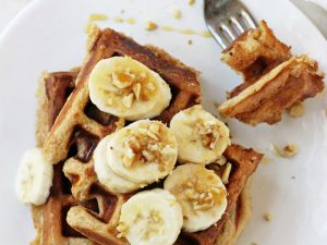Light & filling healthy banana walnut waffles! These whole wheat waffles freeze beautifully, making them perfect for busy mornings!