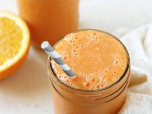This cold busting orange carrot smoothie is nourishing, zippy and creamy! Packed with vitamins, it will help keep your immune system healthy!