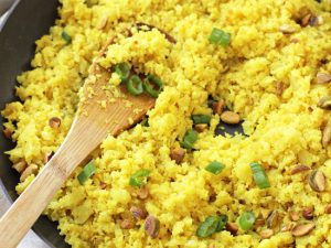 Shake up your side dish routine with this flavorful turmeric cauliflower rice! Simple, healthy and low in carbs, it's a great make-ahead recipe!