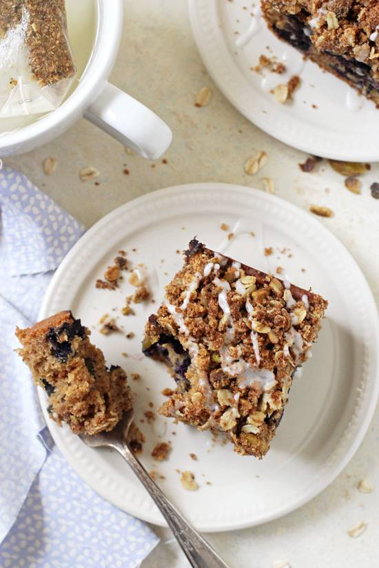 This light & fluffy whole grain blueberry pistachio coffee cake is impossible to resist! Packed with fresh blueberries and topped with a sweet oat streusel topping!
