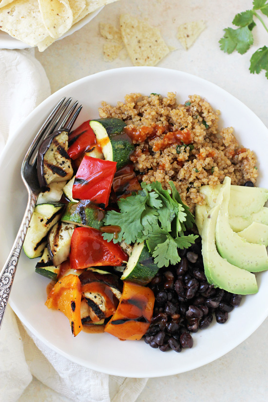 These light & fresh grilled vegetable enchilada bowls are a fantastic summer meal! With a flavorful quinoa pilaf, grilled veggies and plenty of toppings!