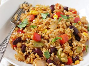 Quick and easy vegetable cajun brown rice! Cooks in one skillet! Packed with veggies, flavorful spices and kidney beans!