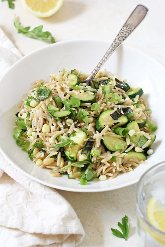 Light & fresh herbed zucchini and corn orzo salad! This healthy and easy pasta dish makes for a great make-ahead meal or side!