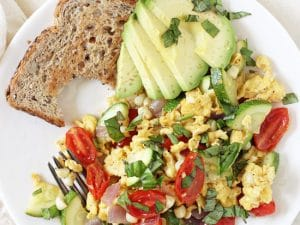 Simple, healthy and filling, this summer veggie egg scramble is perfect for breakfast or dinner! And it comes together in 25 minutes!