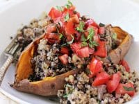 These bruschetta stuffed sweet potatoes are a fantastic make ahead recipe! With baked sweet potatoes, quinoa pilaf and a classic bruschetta topping!