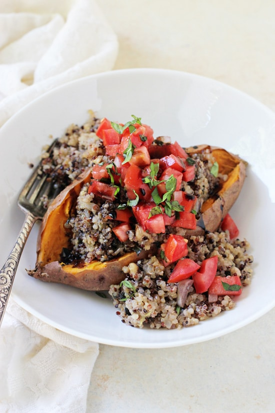 Simple, healthy and delicious bruschetta stuffed sweet potatoes! With a quinoa pilaf, a classic bruschetta topping and balsamic glaze!