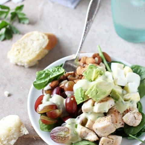 Just 25 minutes to this spinach power salad with yogurt dressing! Filled with juicy grapes, crunchy almonds, sautéed chicken and avocado!