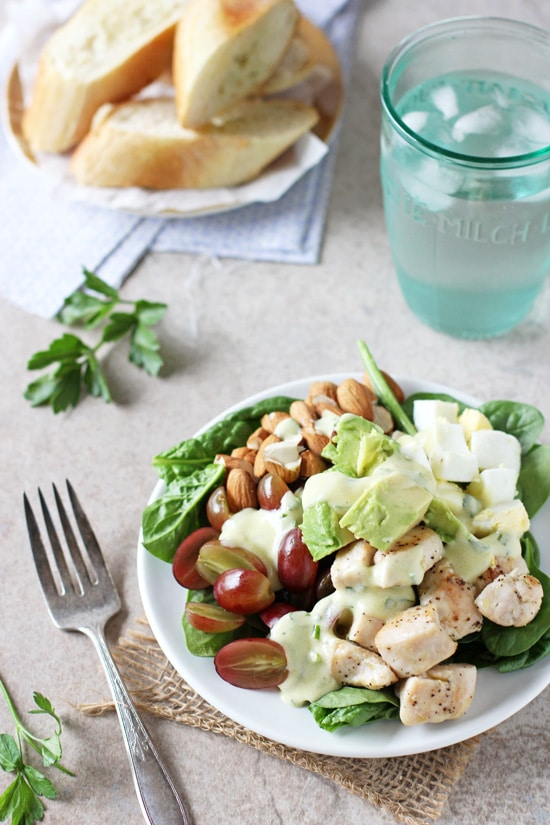 Spinach power salad with yogurt dressing! Filled with fruit, nuts and sautéed chicken! Hearty, wholesome and packed with texture!