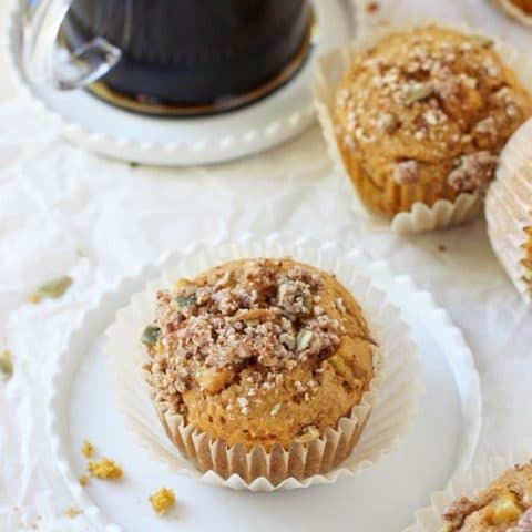 Soft and fluffy harvest sweet potato muffins! These simple muffins are filled with sweet potato puree, maple syrup, whole wheat flour and a crumb topping!