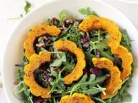 This roasted delicata squash and wild rice salad is perfect for cooler weather! With cranberries, pumpkin seeds and a maple mustard dressing!