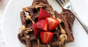 Perfectly light and fluffy chocolate whole wheat waffles! Easy, wholesome and a fantastic make-ahead breakfast! Just reheat in the toaster and go!
