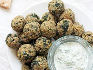 Baked greek vegetarian meatballs! Simple, healthy, protein packed and freezer friendly! Made with chickpeas, walnuts, spinach and sun-dried tomatoes!
