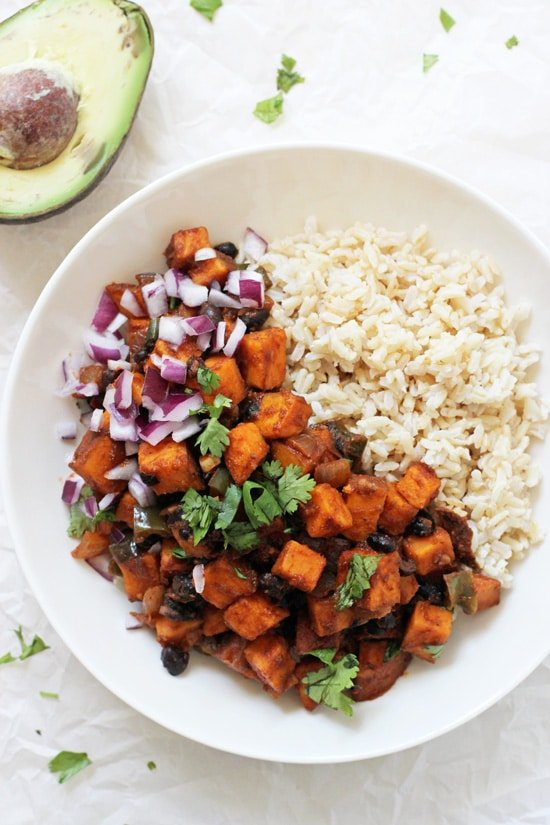 Just 35 minutes to this wholesome sweet potato & black bean enchilada stir-fry! Simple, packed with veggies and easy to customize to your taste!