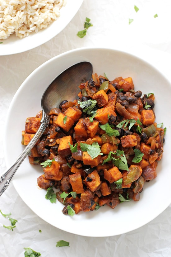 Easy sweet potato & black bean enchilada stir-fry! Packed with green pepper, sweet potatoes, black beans and finished with delicious enchilada sauce!
