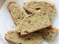 Easy to make whole wheat irish soda bread! Crusty on the outside, dense yet tender on the inside and hard to resist! Especially when slathered with jam! And it's dairy free!