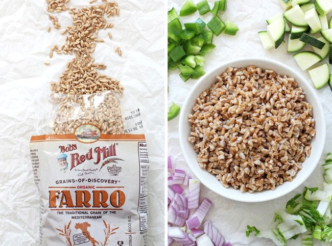 An open bag of Bob's Red Mill Organic Farro and cooked farro in a bowl with chopped veggies all around it.