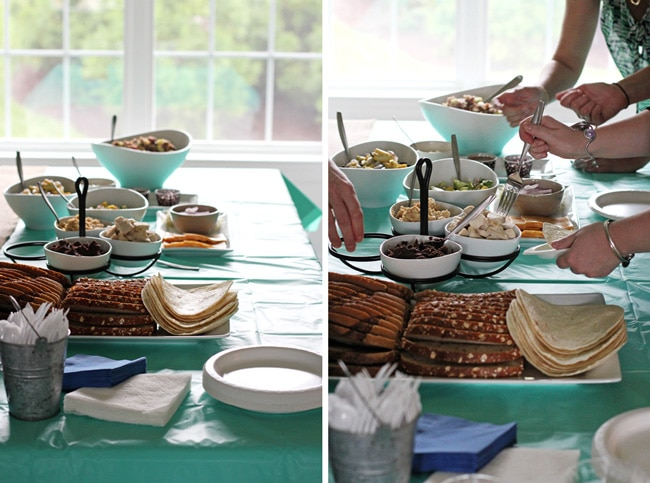 A buffet spread on a dining room table with a turquoise tablecloth.