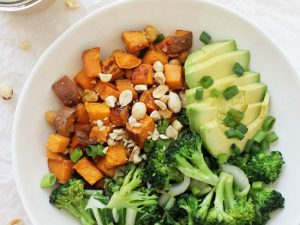 Super simple peanut chickpea sweet potato bowls! This easy meal is packed with roasted sweet potatoes, broccoli, bok choy and peanut sauce! So flavorful and filling!