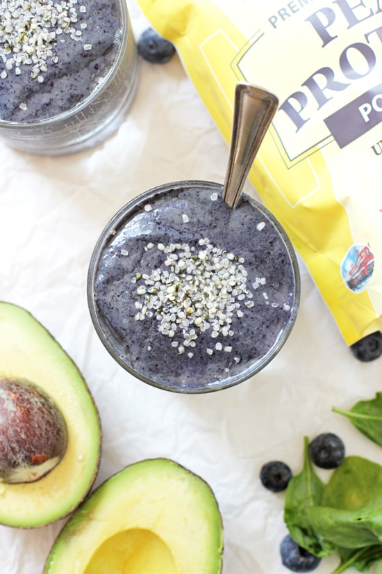 Ready to start your morning off on the right foot? Try this thick and creamy blueberry avocado protein smoothie! With frozen berries, spinach and almond milk!