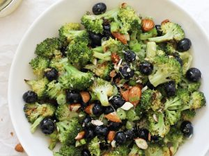 This simple roasted broccoli salad is healthy, fresh and a fun twist on the classic dish! Filled with blueberries, almonds and a maple mustard dressing! Vegan, gluten free, and no mayo in sight!