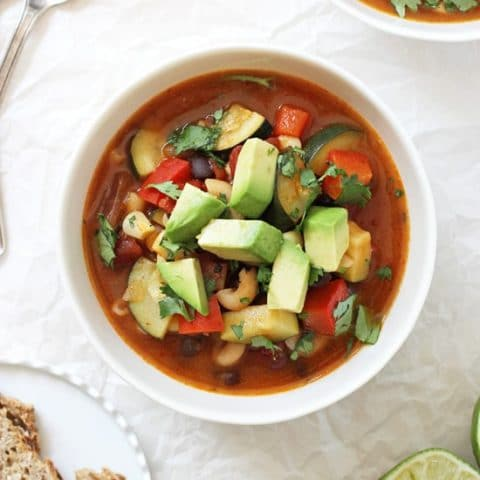 Easy & flavorful homemade mexican minestrone soup! This healthy dinner is packed with zucchini, bell pepper, black beans & spices! Vegan and easily made gluten free!
