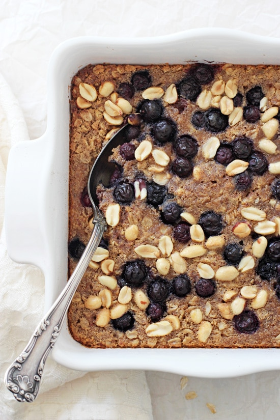 Healthy and simple peanut butter & jelly baked oatmeal! This easy breakfast is packed with oats, berries, peanut butter and maple syrup! Perfect for the whole family!