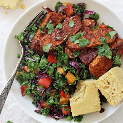 Finger licking good baked BBQ tempeh bowls! This healthy dinner is packed with BBQ tempeh, roasted veggies, tender kale and a creamy dressing! Vegan & gluten free!