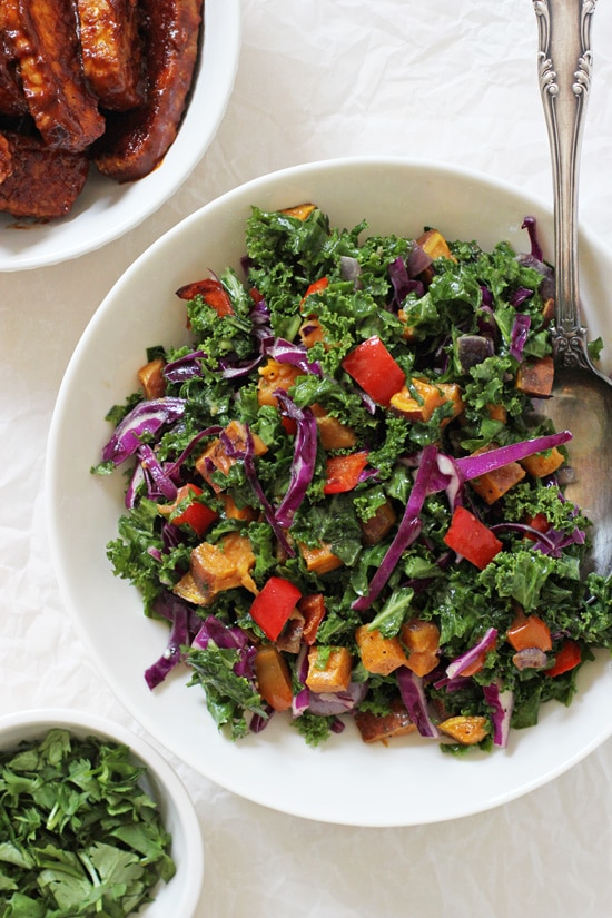 These baked BBQ tempeh bowls make for a healthy lunch or dinner! Featuring a delicious kale salad base, roasted veggies and BBQ baked tempeh!