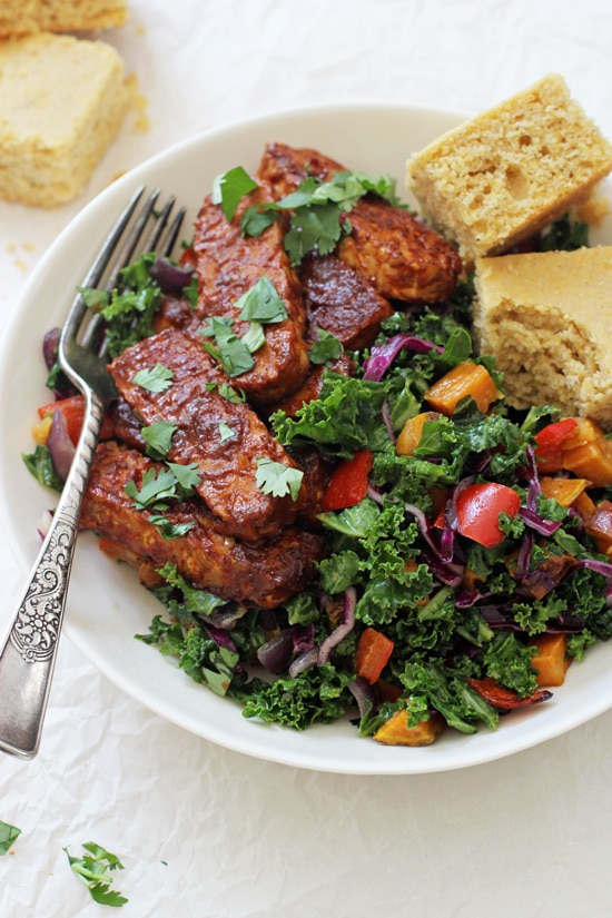 Packed with veggies and protein, these baked BBQ tempeh bowls make for a healthy and delicious dinner! With roasted sweet potatoes, tender kale, BBQ tempeh and a creamy dressing! Vegan & gluten free!