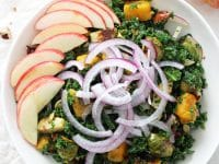 Easy fall harvest kale salad! This hearty and healthy salad is filled with massaged kale, roasted brussels sprouts, butternut squash, crunchy pecans and sliced apple! All tied together with a dreamy maple vinaigrette! Vegan and gluten free! And perfect for the holidays!