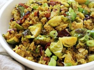 Healthy cranberry quinoa salad with brussels sprouts! Filled with crunchy almonds, dried cranberries and warm spices, it's perfect for make-ahead meals or sides! Vegan & gluten free!