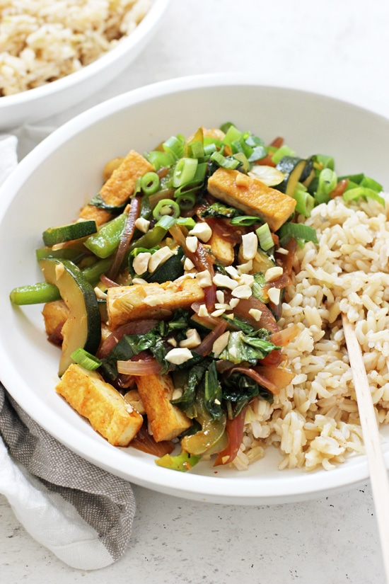 This kung pao tofu is a healthy and lighter take on the classic take-out dish! With a simple sauce made with pantry staples and packed with tons of veggies! Easy, vegan and gluten free!