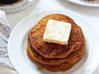 Tender, fluffy, melt-in-your mouth vegan sweet potato pancakes! These easy and healthy pancakes are filled with sweet potato puree, almond milk, cinnamon and olive oil! And they reheat beautifully, making them perfect for busy mornings!