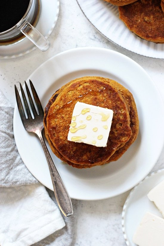 Fluffy and oh-so-tender vegan sweet potato pancakes! These easy pancakes come together in a snap and are filled with wholesome ingredients! A must for fall and winter mornings! Serve with your favorite toppings, like nut butter, maple syrup or coconut whipped cream!