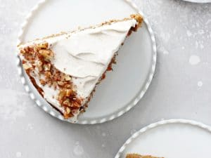 This dreamy dairy free carrot cake is soft, moist and packed with fresh carrots and pecans! Topped with a dairy free cream cheese icing that is absolutely delicious! Perfect for spring baking or anytime of the year!