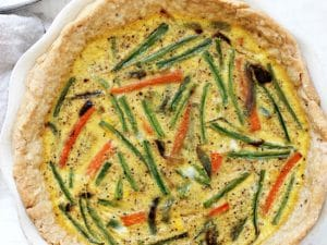 Veggie packed dairy free quiche! Made with a coconut oil pie crust, eggs, almond milk and lots of colorful veggies! It's a lighter take on the classic brunch dish! Perfect for potlucks, mother's day and easter!