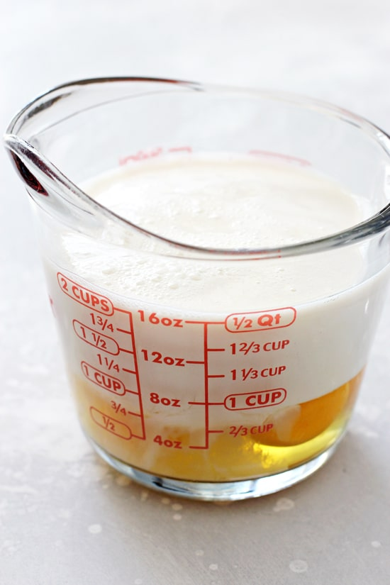 Eggs and almond milk in a large glass measuring cup.