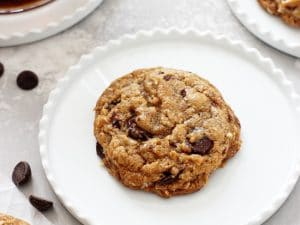 Perfectly soft and chewy coconut oil oatmeal cookies! Super easy to make and no mixer required! Packed with rolled oats and dark chocolate chips, these dairy free cookies are excellent for any day of the week!