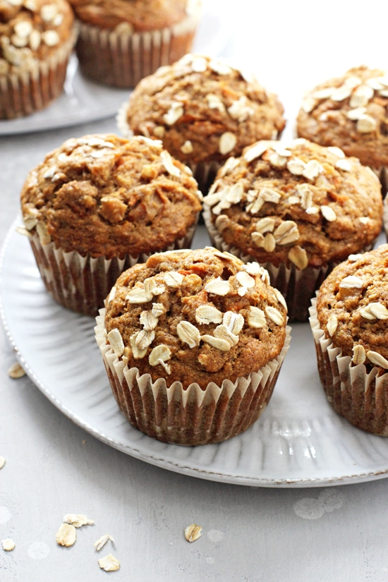 A white plate filled with Banana Carrot Muffins.