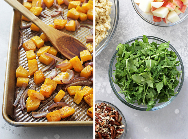 A tray of roasted butternut squash, and chopped arugula, quinoa and apples in small bowls.
