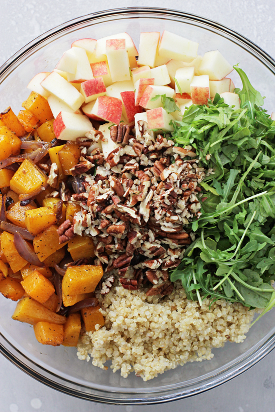 All the components for Butternut Squash Quinoa Salad in a mixing bowl.