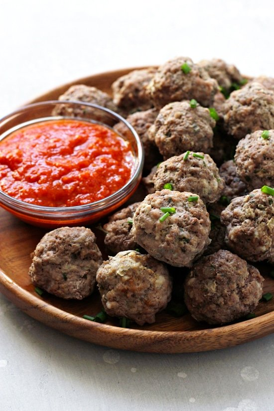 Gluten Free Dairy Free Meatballs on a wooden plate.