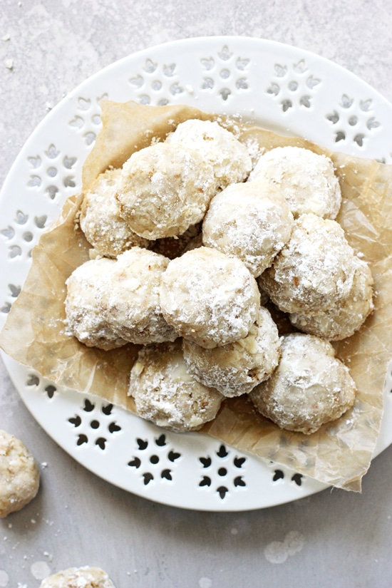 A white plate filled with Vegan Snowball Cookies.