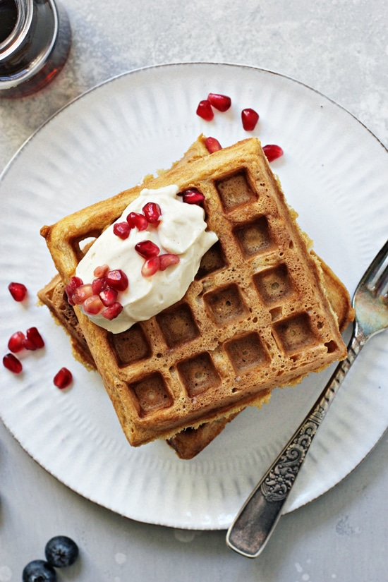 Two Classic Dairy Free Waffles on a white plate with a fork.