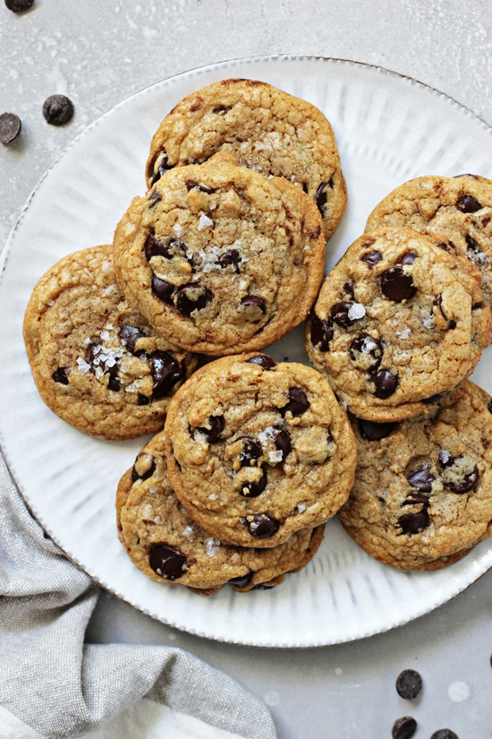 A white plate filled with Coconut Oil Chocolate Chip Cookies.