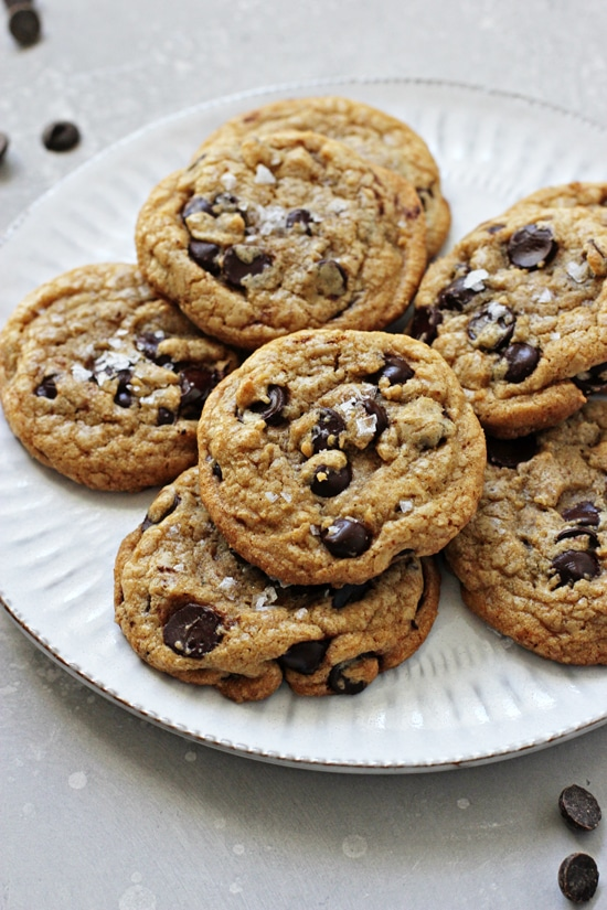 A white plate filled with Chocolate Chip Cookies with Coconut Oil.