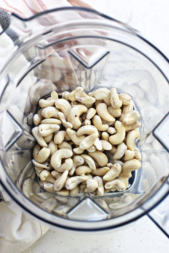 Raw cashews in a blender.