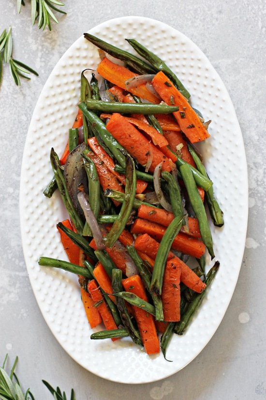 Roasted Green Beans and Carrots on a white serving platter.