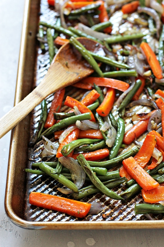 Roasted Carrots and Green Beans fresh out of the oven on a baking sheet.