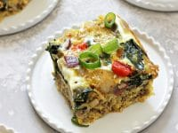 Three pieces of Dairy Free Breakfast Casserole on white plates.